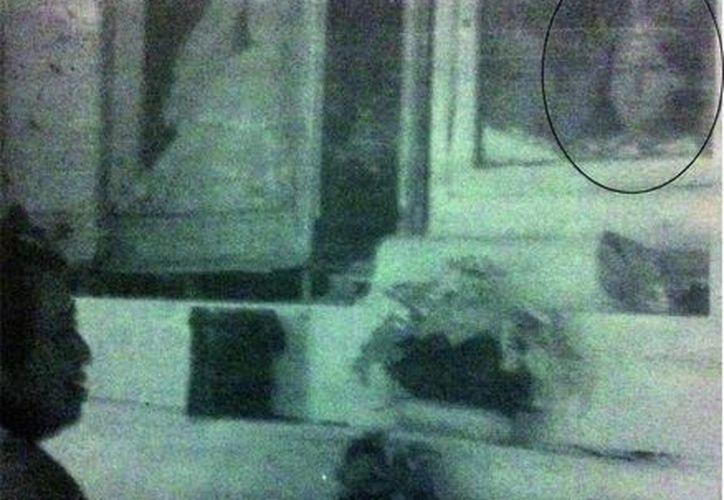 Antigua foto tomada a principios del siglo pasado a la imagen de la virgen decapitada, en Umán. (Jorge Moreno/SIPSE)