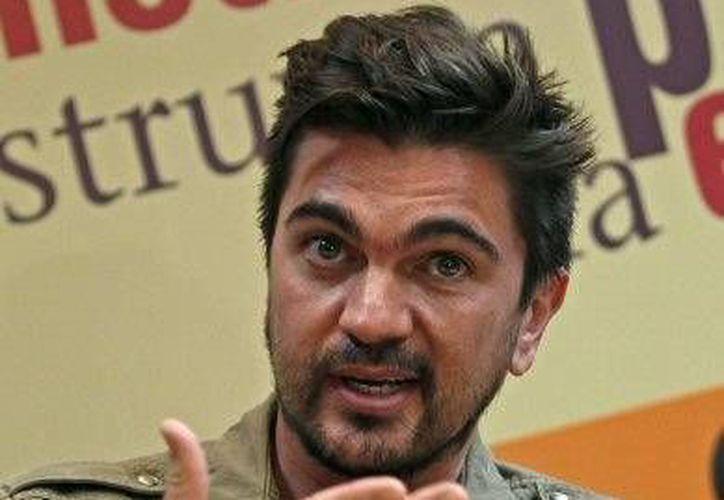 Juanes quiere llevar su 'sangre' a los jóvenes de zonas empobrecidas un año más en conjunto con el Banco Mundial. (Agencias)