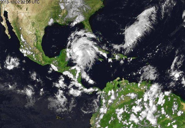 Foto que difunde la Conagua en la que se aprecia la cada vez más cerrada circulación ciclónica de la baja presión. (Cortesía)