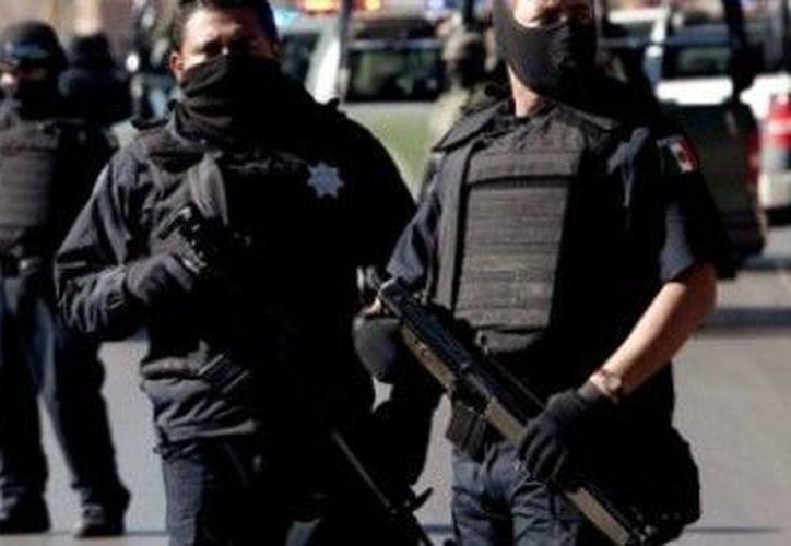 Agentes de Ecatepec arrestaron a los plagiarios al momento en que pedían dinero a cambio de la víctima. (Notimex/Foto de contexto)