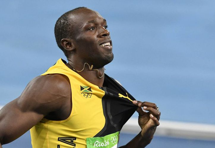 Usain Bolt ha manifestado en varias ocasiones su intención de jugar futbol con algún equipo profesional.(Martin Meissner/AP)