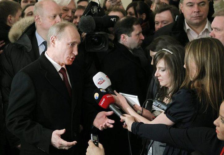 El presidente de Rusia, Vladimir Putin, es uno de los líderes cuyos movimientos corporales son estudiados por el pentágono. (EFE)