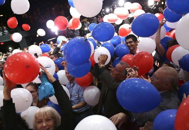 La comunidad hispana representó el ocho por ciento del electorado total que participó en las legislativas de este martes. (AP)