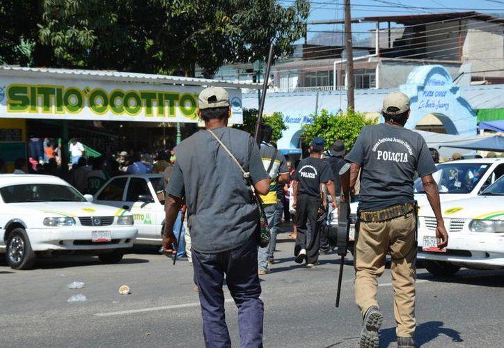 Los policías comunitarios de Michoacán combatieron al crimen organizado mientras llegaba el apoyo federal y militar. (Notimex/Archivo)