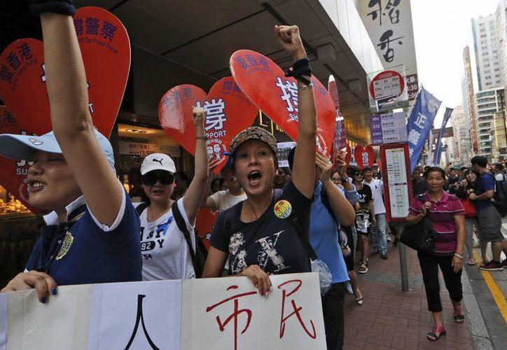 Los manifestantes exigen un cambio en la política de selección de candidatos para las elecciones de Hong Kong en 2017. (AP)