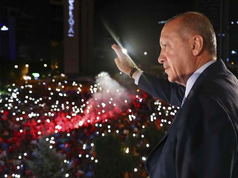 Turkey's President Recep Tayyip Erdogan, waves to supporters of his ruling Justice and Development Party (AKP) in Ankara, Turkey.