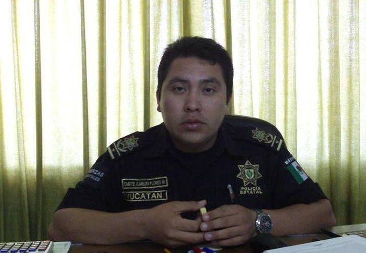El comandante Carlos Flores Moo destacó que solo las policías municipales de Mérida, Tizimin y Valladolid están enlazadas con el sistema nacional de seguridad. (Manuel Pool/SIPSE)