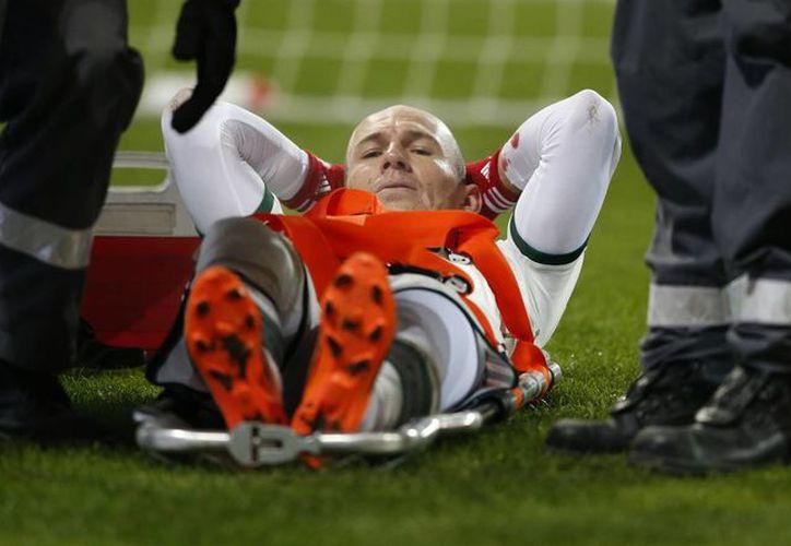 Robben metió un gol frente al Augsburgo entre semana antes de salir lesionado. (Agencias)