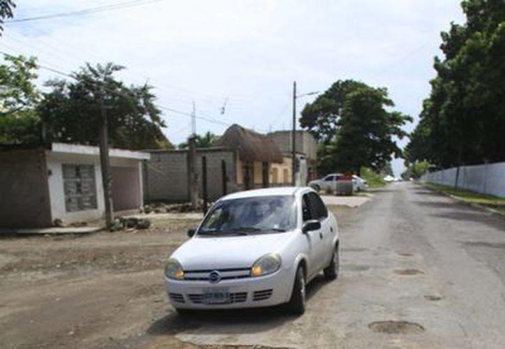 La denuncia buscaba responsabilizar al municipio por el pago de daños sufridos en un vehículo a causa de baches en la vialidad. (Harold Alcocer/SIPSE)