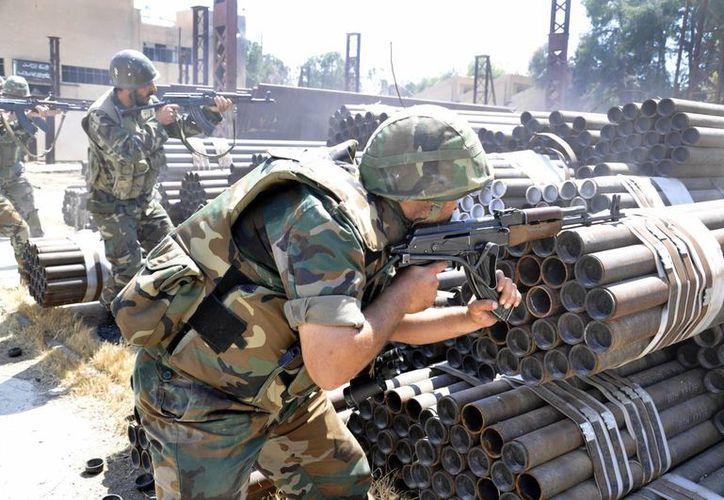 ONU denunció que grupos que combaten contra Assad usaron a civiles como escudos humanos. (Agencias)