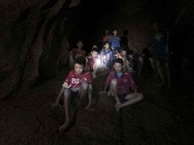The boys, aged 11-16, and their 25-year-old coach were described as healthy and being looked after by seven members of the Thai navy SEALs. AP