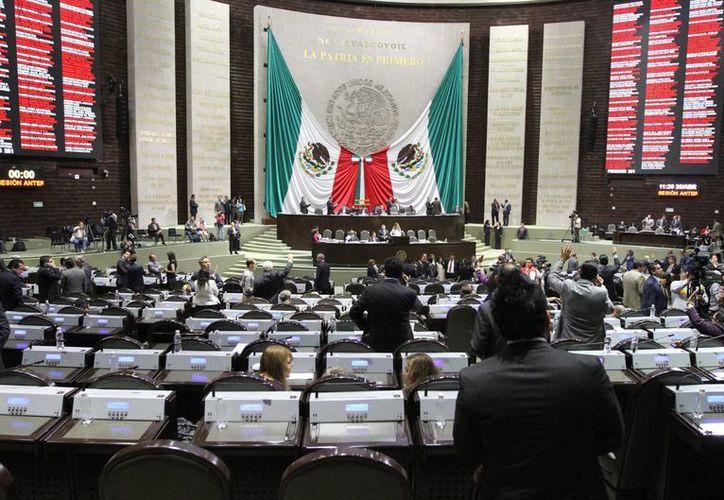 El grupo parlamentario del PRI, PAN y PRD de la Cámara de Diputados no presidirán tantas comisiones como están acostumbrados. Imagen de archivo. (Archivo/Notimex)