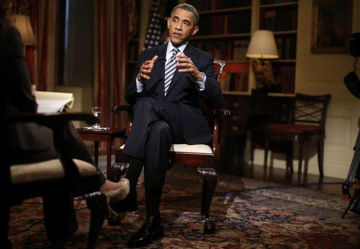 El presidente Barack Obama durante una entrevista exclusiva en la biblioteca de la Casa Blanca. (Agencias)
