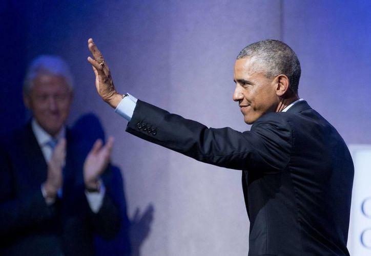 Obama llamó a los líderes mundiales a terminar 'viejas divisiones' y alcanzar un acuerdo sobre el calentamiento global. (AP)