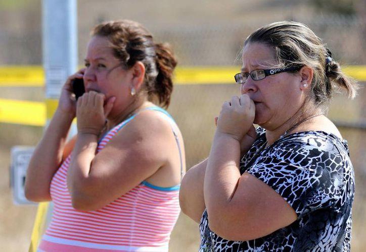 Las autoridades están investigando los motivos que tuvo el autor del tiroteo en una universidad de Roseburg, en Oregon. (AP)