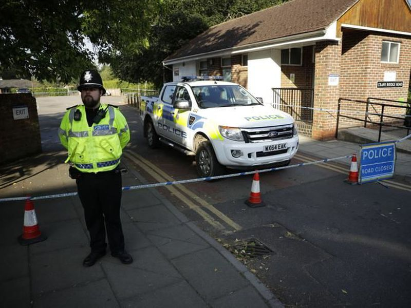 A British police officer guards a cordon which was extended overnight to include the Lush House car park adjacent to the Queen Elizabeth Gardens park, in Salisbury, England. (AP)