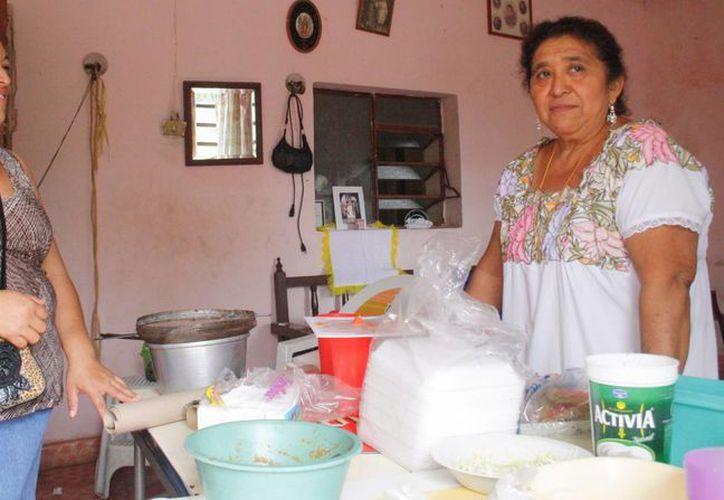 La familia Dzib Tuz se verá desplazada por la expropiación de tierras. (Octavio Martínez/SIPSE)
