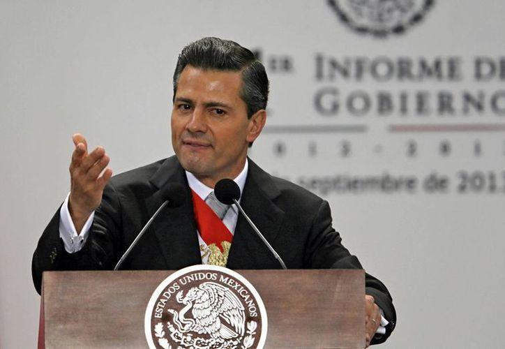 El presidente Enrique Peña Nieto durante su Primer Informe de Gobierno, rendido este lunes. (Agencias)