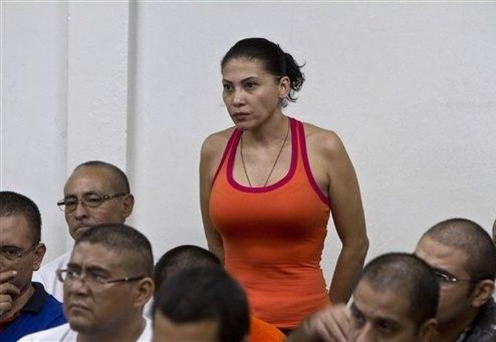 La DAJ ha identificado a Raquel Alatorre Correa como la líder de la banda que trasegaba 9.2 millones de dólares al momento de su detención. (Archivo/AP)