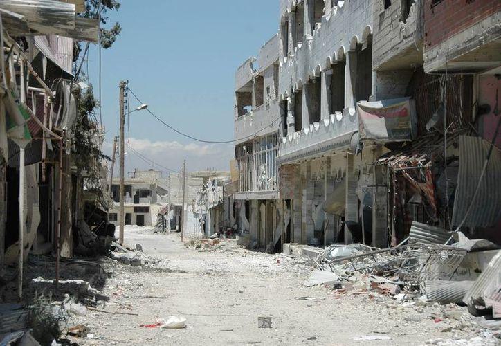 Vista general de los daños en edificios, en la localidad estratégica de Al Quseir, Siria. (Archivo/EFE)