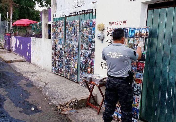Agentes ministeriales decomisaron discos y películas pirata en Valladolid. (Milenio Novedades)