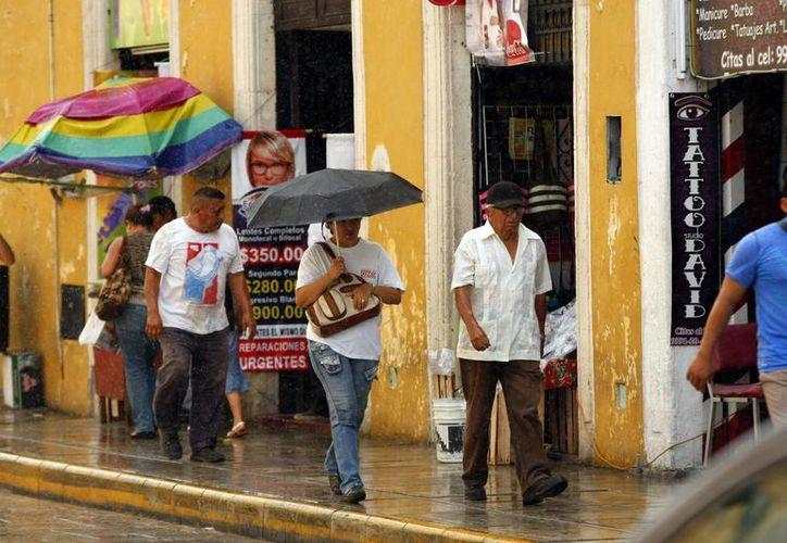 Este miércoles llovió en varias zonas de Mérida, incluyendo el centro de la ciudad. (Christian Ayala/SIPSE)
