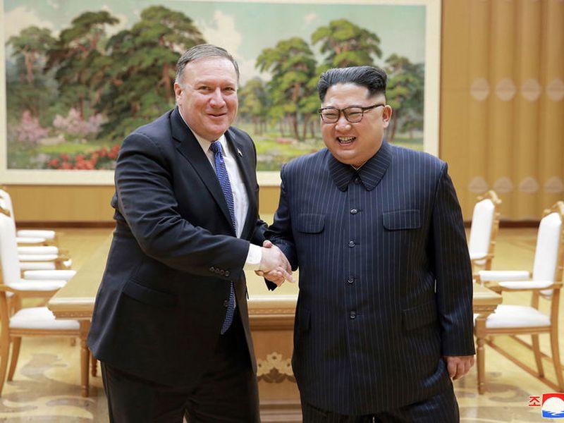U.S. Secretary of State Mike Pompeo, left, shakes hands with North Korean leader Kim Jong Un, in Pyongyang, North Korea.