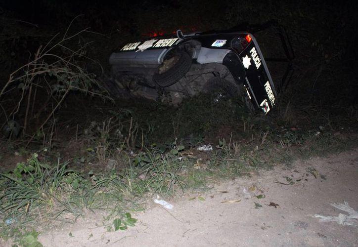 Una patrulla quedó volcada tras un choque en Felipe Carrillo Puerto. (Redacción/SIPSE)