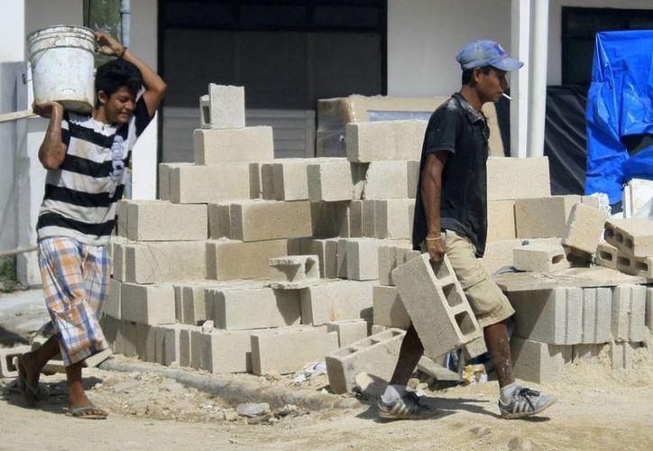 El gobierno del Estado le adeuda más de 500 millones de pesos a poco más de 80 empresarios afiliados a CMIC. (Archivo/SIPSE)