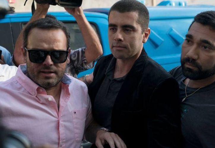 Denis Furtado era buscado por la policía desde el domingo, por cargos de homicidio y asociación criminal.  (Foto: AP)