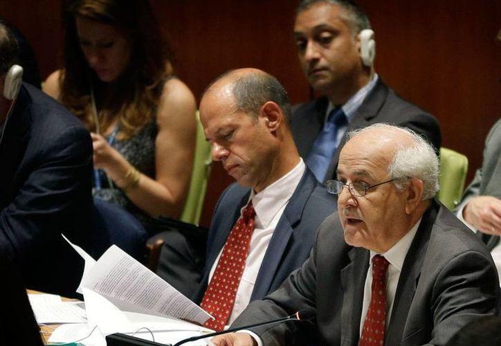 El sonido de la balas y los misiles se transformó en el silencio de la paz, pero sólo por unos días en los que las partes en conflicto, Israel y Hamás, comienzan el diálogo. La imagen corresponde a una reunión informal de la ONU sobre la guerra en Gaza. (AP)