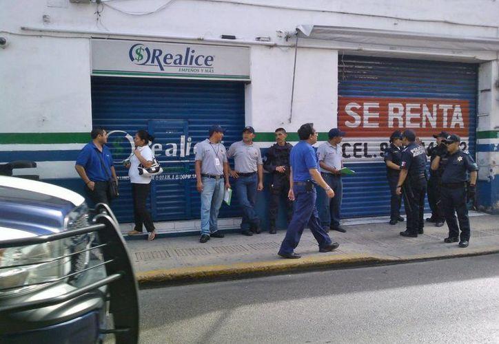 """El cuantioso robo se cometió en el negocio de empeños """"Realice"""", ubicado en el centro de Mérida. (Milenio Novedades)"""