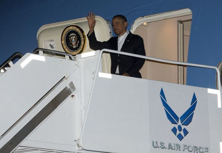 El presidente Obama a su llegada a Hawaii. (Agencias)
