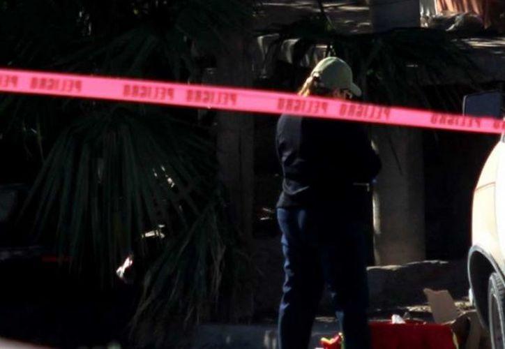 Dos cabezas humanas fueron encontradas dentro de una hielera, este domingo en Cabo San Lucas. (Excélsior)