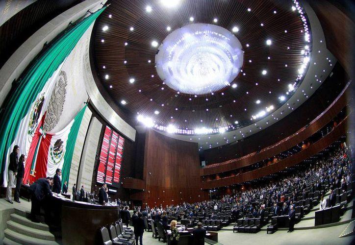 La iniciativa del Partido Acción Nacional plantea reformar los artículos 23 y 51 de la Ley General de Partidos Políticos. Imagen de una sesión en la Cámara de Diputados, en la ciudad de México. (Archivo/Notimex)
