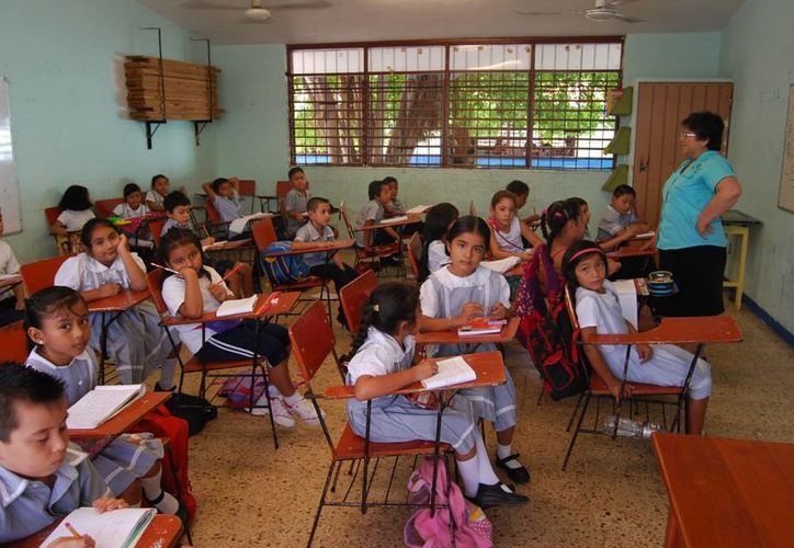 La participación activa entre directivos, docentes y padres de familia que hacen una educación integral las pusieron en el nivel más alto. (Tomás Álvarez/SIPSE)