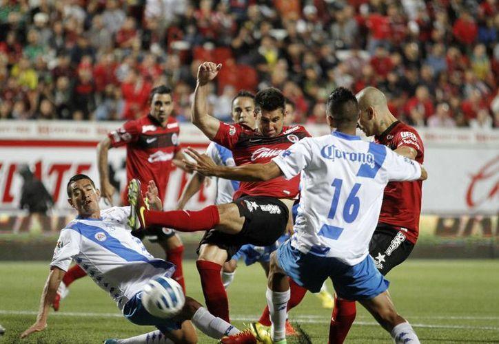 La escuadra tijuanense buscó el empate, pero le costaba trabajo llegar con peligro a la meta del visitante. (Notimex)