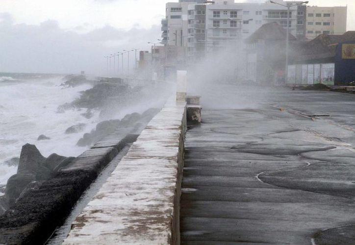 La presencia de una zona de inestabilidad en el Golfo de México provocará lluvias torrenciales en el estado de Veracruz, advirtió el Servicio Meteorológico Nacional. (Archivo/Notimex)