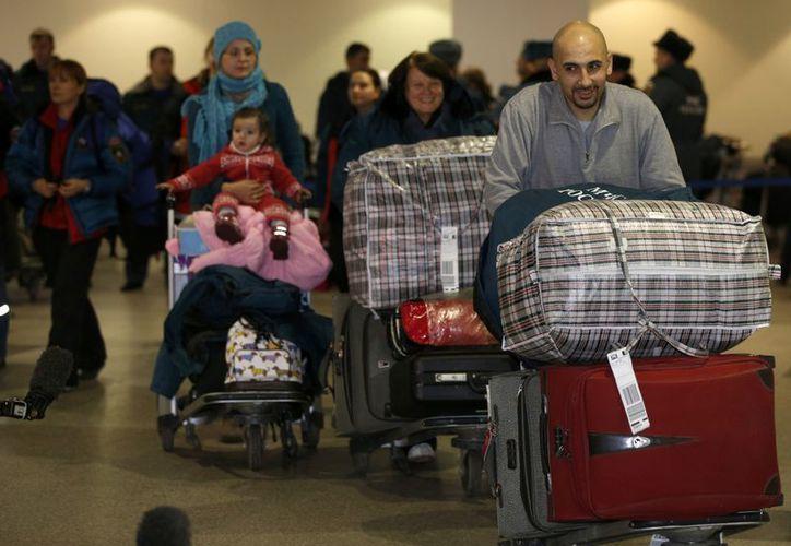 Unos mil rusos salieron de Siria en las últimas horas. (Agencias)