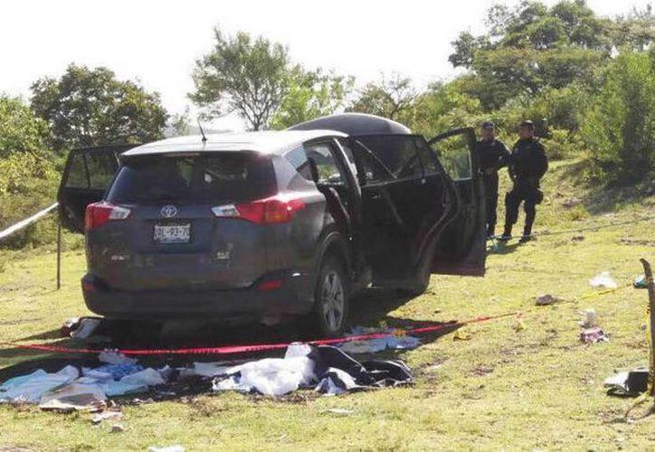 Imagen de la escena del crimen, en la que fue asesinado el alcalde de Huehuetlán El Grande, Puebla, José Santamaría Zavala, en agosto pasado. (Augusto Simón/expansión.mx)