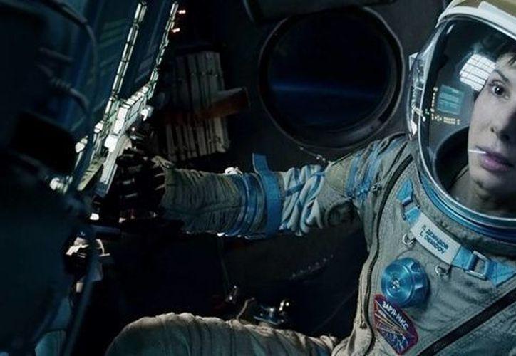 Cuarón convenció a Bullock de que interpretara a la astronauta que enfrenta un desastre en la EEI justo cuando la actriz había decidido descansar de Hollywood. (Agencias)