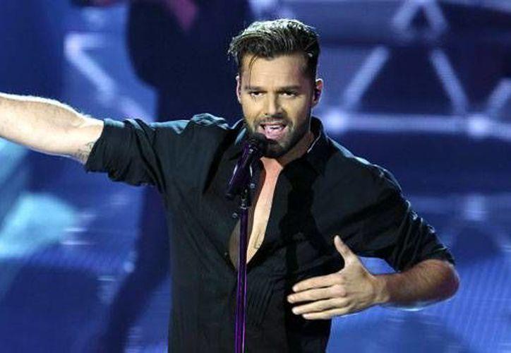 Ricky Martin enfrenta una demanda por supuesto plagio del video musical 'Vida', el cual fue tema del Mundial de Brasil 2014. (Archivo AP)