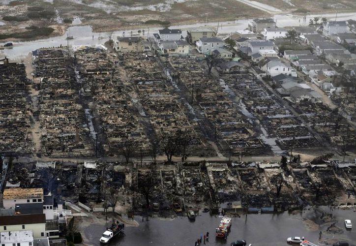 Casi mil mexicanos perdieron todas sus pertenencias a consecuencia del huracán Sandy. (Agencias)