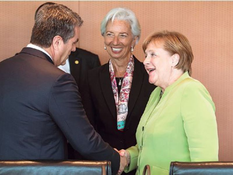 German Chancellor Angela Merkel, right, welcomes Christine Lagarde, center, Managing Director of the International Monetary Fund, IWF, and Roberto Carvalho de Azevedo, left, Director-General of the World Trade Organization, WTO, for a meeting at the chancellery in Berlin, Germany.