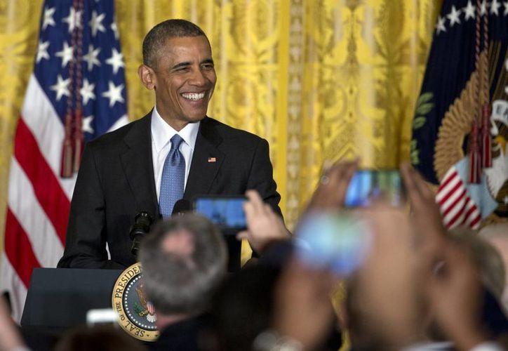 El presidente estadounidense Barack Obama afirmó que ahora 90 por ciento de la población cuenta con un seguro de salud. (Agencias)