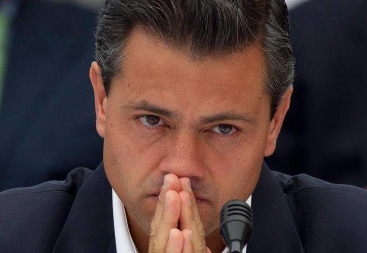 Enrique Peña Nieto debe afrontar una rebelión en las filas de su partido por la postulación de Enrique Ochoa. (Archivo/Agencias)