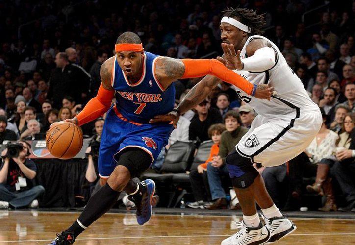Carmelo Anthony, de 32 años y de Knicks de Nueva York, es uno de los jugadores que acudirá con la selección de basquetbol de Estados Unidos a Rio 2016. (nytimes.com)