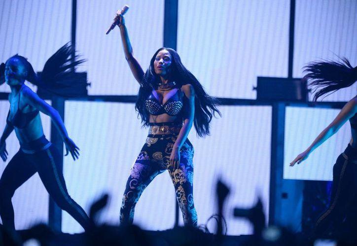 Presentación de Nicki Minak en Las Vegas en septiembre del año pasado. Uno de los dos miembros de su equipo que fueron agredidos hace horas afuera de un bar de Philadelphia, falleció. (Foto: AP)