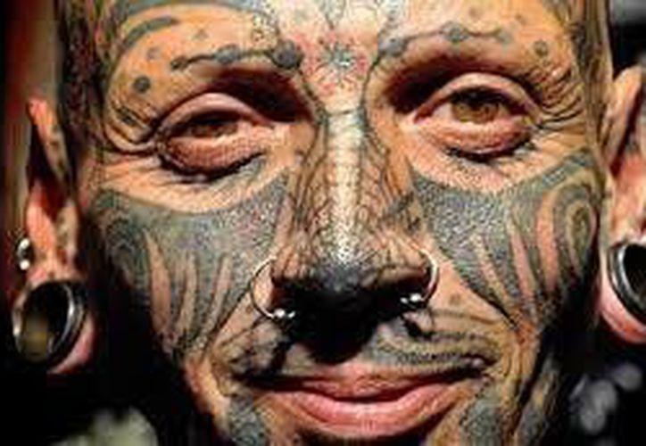En algunas empresas, no se aceptan a personas con tatuajes. (Contexto/Internet)