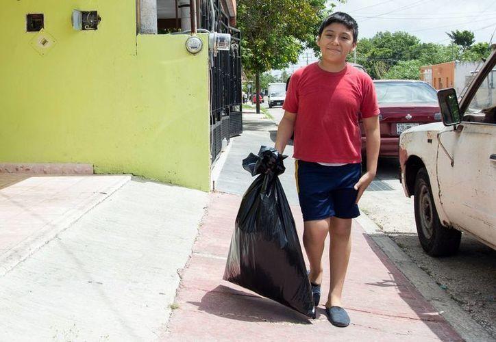 Muchos meridanos aún separan la basura doméstica. (Milenio Novedades)
